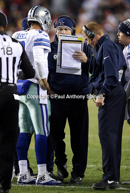 Dallas Cowboys offensive coordinator Scott Linehan talks to Dallas Cowboys quarterback Matt Cassel (16) as Dallas Cowboys head coach Jason Garrett (right) listens in during a sideline break during the 2015 week 13 regular season NFL football game against the Washington Redskins on Monday, Dec. 7, 2015 in Landover, Md. The Cowboys won the game 19-16. (©Paul Anthony Spinelli)