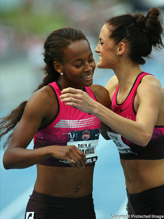 MUHAMMAD.MOLINE - 13USA, Des Moines, Ia. - Dalilah Muhammad, left, and Georganne Moline shared a moment of sportsmanship after finishing first and second in the 400 hurdles.  Photo by David Peterson