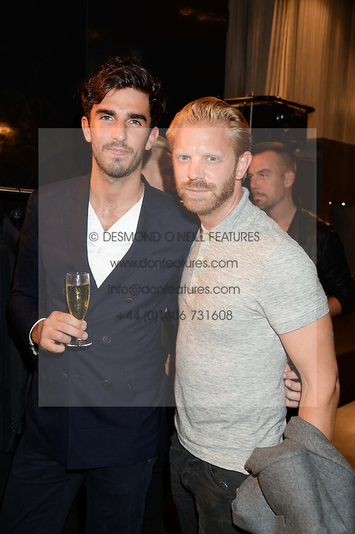 Left to right, TEO VAN DEN BROEKE and ALISTAIR GUY at the opening of the Tiger of Sweden Store, 210 Piccadilly, London on 3rd October 2013.