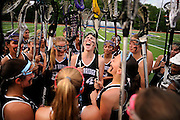 Kayla Bravo (middle), along with the Old Bridge lacrosse team, huddle together for a group cheer prior the Greater Middlesex Conference championship game against North Brunswick held at North Brunswick Township High School on May 11.