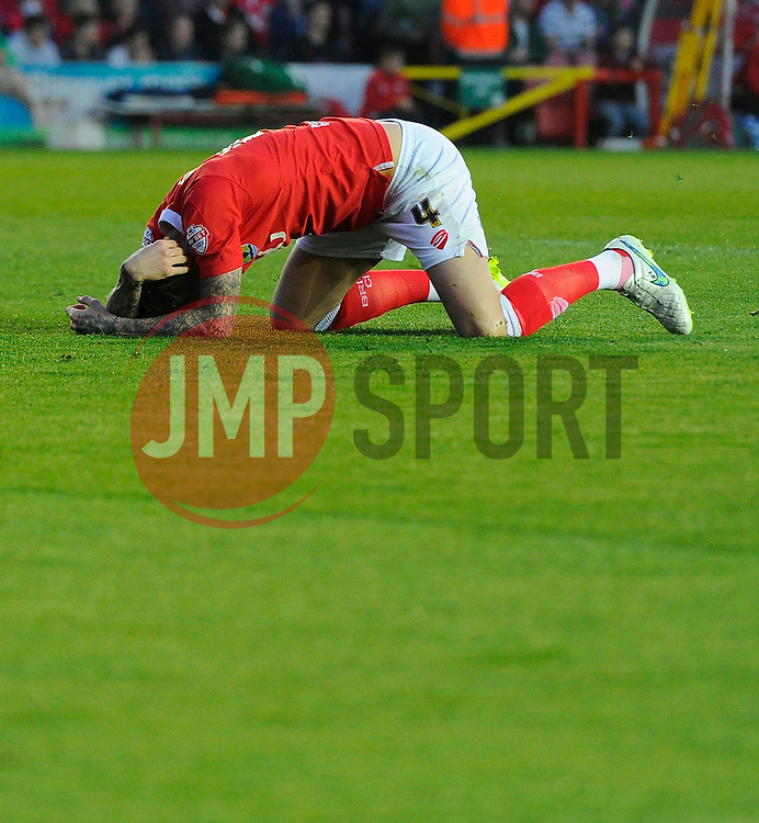 Bristol City's Aden Flint holds his head - Photo mandatory by-line: Joe Meredith/JMP - Mobile: 07966 386802 - 07/04/2015 - SPORT - Football - Bristol - Ashton Gate - Bristol City v Swindon Town - Sky Bet League One