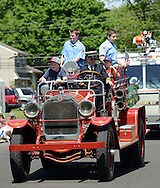 WARMINSTER, PA - MAY 26:  Members of the Hartsville Fire Company ride in an old fire truck during the Warminster Memorial Day Parade and Ceremony May 26, 2014 in Warminster, Pennsylvania. (Photo by William Thomas Cain/Cain Images)