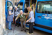 AGE UK, local elderly residients arrive at the day centre. Bath and West Community Energy. Bath, Somerset.
