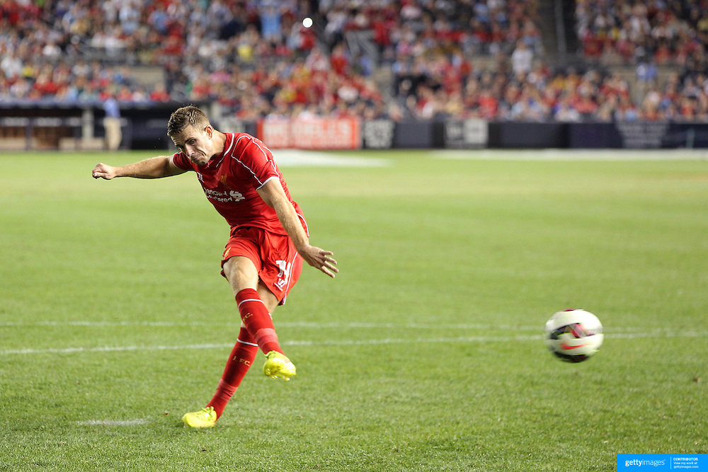 Jordan Henderson, Liverpool, scoring a penalty kick during  the penalty shoot out after the Manchester City Vs Liverpool FC Guinness International Champions Cup match at Yankee Stadium, The Bronx, New York, USA. 30th July 2014. Photo Tim Clayton