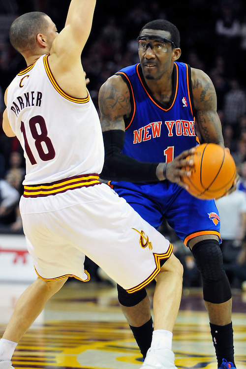 Feb. 25, 2011; Cleveland, OH, USA; Cleveland Cavaliers shooting guard Anthony Parker (18) puts pressure on New York Knicks power forward Amare Stoudemire (1) during the fourth quarter at Quicken Loans Arena. The Cavaliers beat the Knicks 115-109. Mandatory Credit: Jason Miller-US PRESSWIRE