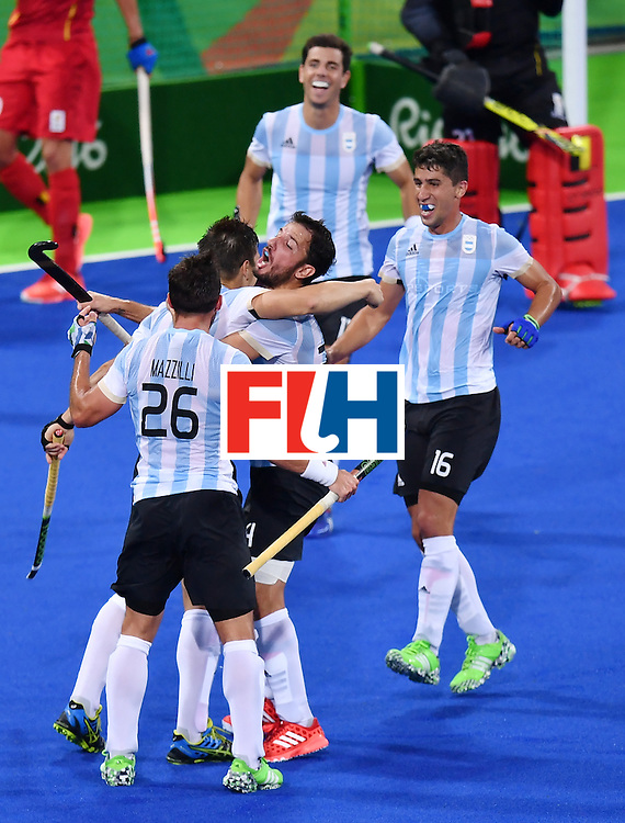 Argentina's players celebrate their third goal during the men's Gold medal field hockey Belgium vs Argentina match of the Rio 2016 Olympics Games at the Olympic Hockey Centre in Rio de Janeiro on August 18, 2016. / AFP / MANAN VATSYAYANA        (Photo credit should read MANAN VATSYAYANA/AFP/Getty Images)