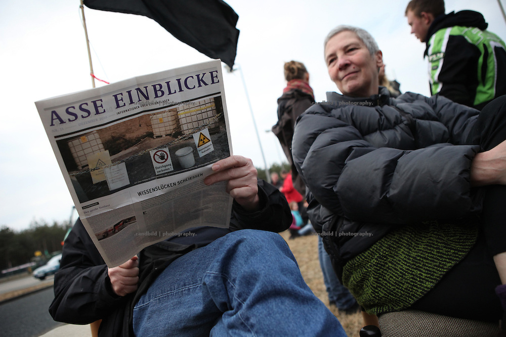 A anti-nuclear activist reads a pro-nuclear magazine during protests in Gorleben. One day after a worse explosion in the fukushima nuclear power plant in Japan 500 protesters entered the Gorleben nuclear facilities in northern Germany. The regular sunday protest became strong as demonstraters opend the first of three security gates of the saltmine of Gorleben. The Mine is proposed to become Germanys first final storage for high radioactive nuclear waste. Accompanied by 20 tractors protesters encircled a well tower by a human chain and demanded it´s closure.