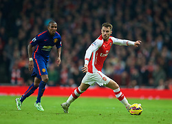 LONDON, ENGLAND - Saturday, November 22, 2014: Arsenal's Aaron Ramsey in action against Manchester United during the Premier League match at the Emirates Stadium. (Pic by David Rawcliffe/Propaganda)