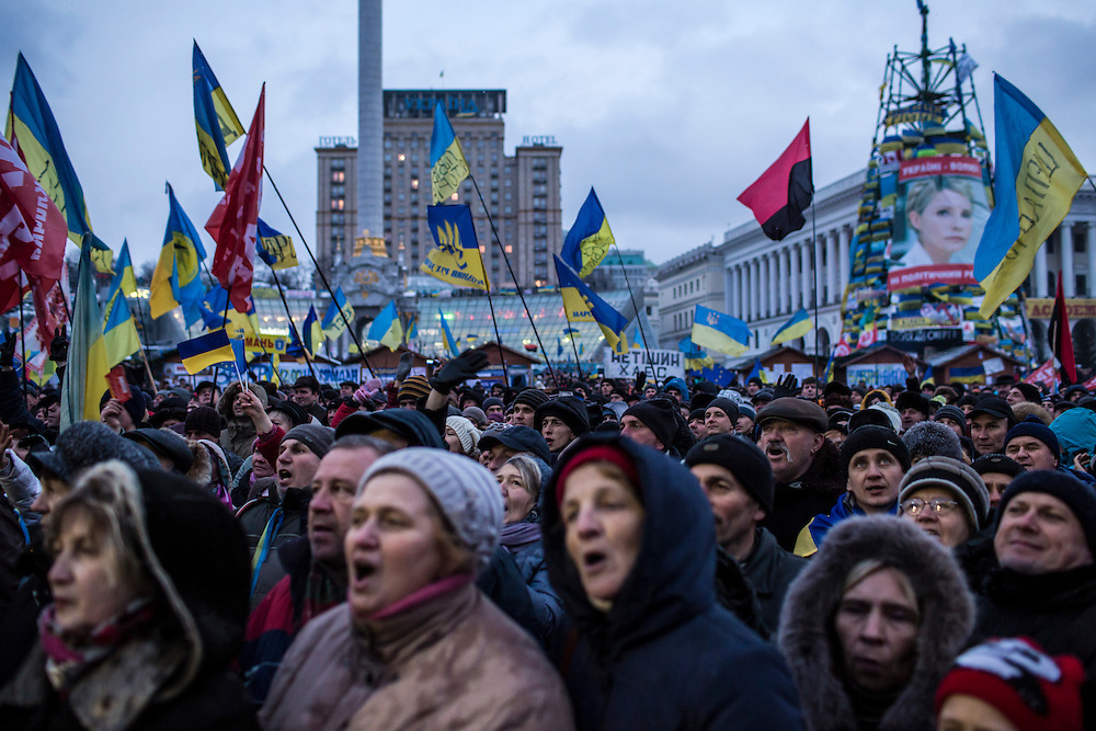 KIEV, UKRAINE - DECEMBER 7: Anti-government protesters rally on Independence Square on December 7, 2013 in Kiev, Ukraine. While initial protests were mainly comprised of students, violent clashes with police in which dozens of young people were injured brought Ukrainians of all ages into the streets. (Photo by Brendan Hoffman/Getty Images)