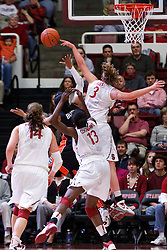 February 24, 2011; Stanford, CA, USA;  Stanford Cardinal forward Mikaela Ruef (3) blocks a shot from Oregon St. Beavers guard Alexis Bostick (2) during the first half at Maples Pavilion.