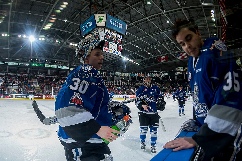 KELOWNA, CANADA - FEBRUARY 12: Griffen Outhouse #30 stands at the bench with Dean McNabb #35 of the Victoria Royals during a time out against the Kelowna Rockets  on February 12, 2018 at Prospera Place in Kelowna, British Columbia, Canada.  (Photo by Marissa Baecker/Shoot the Breeze)  *** Local Caption ***