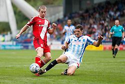 Grant Leadbitter of Middlesbrough is challenged by Mark Hudson of Huddersfield - Photo mandatory by-line: Rogan Thomson/JMP - 07966 386802 - 13/09/2014 - SPORT - FOOTBALL - Huddersfield, England - The John Smith's Stadium - Huddersfield town v Middlesbrough - Sky Bet Championship.