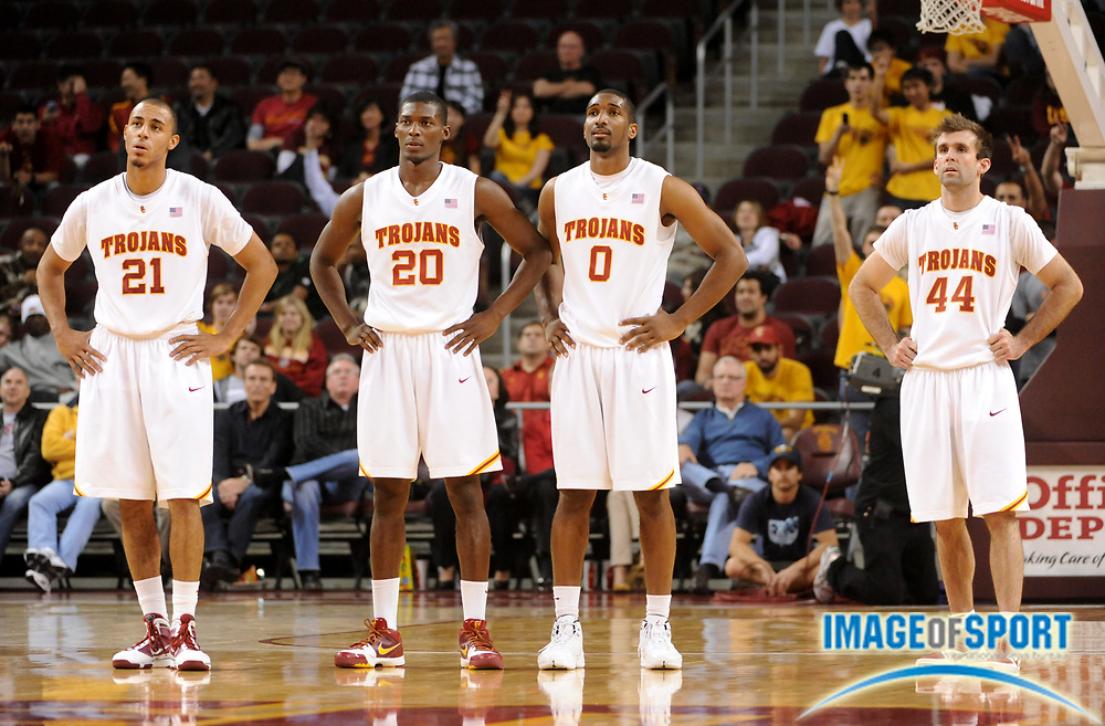 Jan 2, 2010, Los Angeles, CA, USA; Southern California Trojans players Dwight Lewis (21), Marcus Simmons (20), Marcus Johnson (0) and Mike Gerrity (44) watch during the second half of the game against the Arizona State Sun Devils at the Galen Center. USC defeated Arizona State 47-37.