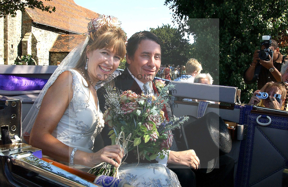 The bride LADY CRISTABEL DURHAM and her husband JOOLS HOLLAND at the wedding of musician Jools Holland to Lady Crystabel Durham held at Cooling Village Church, Cooling, Kent on 30th August 2005.<br />