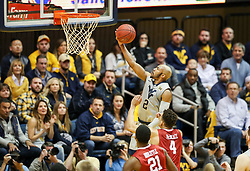 Jan 6, 2018; Morgantown, WV, USA; West Virginia Mountaineers guard Jevon Carter (2) shoots a layup during the first half against the Oklahoma Sooners at WVU Coliseum. Mandatory Credit: Ben Queen-USA TODAY Sports