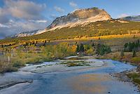 Saint Mary River and Single Shot Mountain in autumn, Glacier National park Montana USA