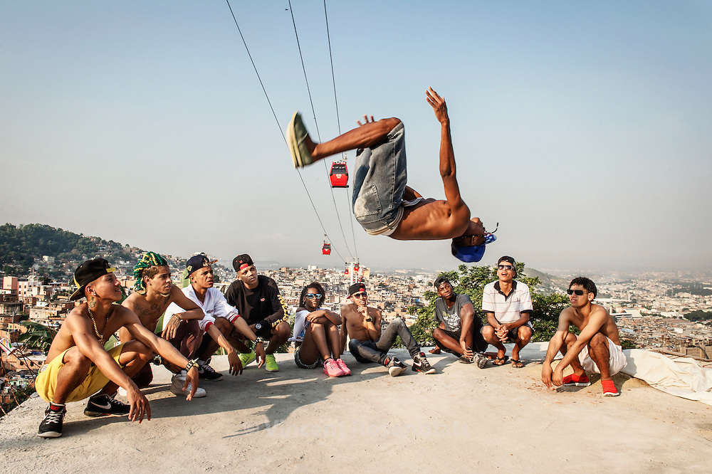 "Ronald ""Sheick"", one of the best ""passinho"" dancer of Rio de Janeiro. Rehearsal of the show  ""Na Batalha"" on a rooftop of the Complexo do Alemão favelas. Elite dancers of the ""Passinho"" (little step) the newest dance fever that came out the Baile Funk culture."