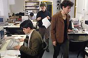 (from left) Lucia Manassi, Michele Migone, Marco Formigoni, journaists, at work in the newsroom of Radio Popolare (Popular Radio) at Stradella street, in Milan, 1992. Radio Popolare is an Italian free and indipendent radio station; its programs are broadcasted on FM and streaming and by satellite. &copy; Carlo Cerchioli<br /> <br /> I giornalisti (da sin.) Lucia Manassi, Michele Migone, Marco Formigoni al lavoro nella redazione di Radio Popolare in via Stradella, Milano, 1992. Radio Popolare, &egrave; una radio di informazione libera e indipendente; i suoi programmi sono trasmessi in FM e streaming e via satellite.