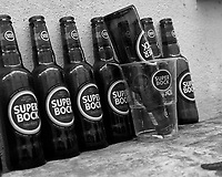 Super Bock -- The Morning After. Street Photography in Lisbon. Image taken with a Leica CL camera and 23 mm f/2 lens.