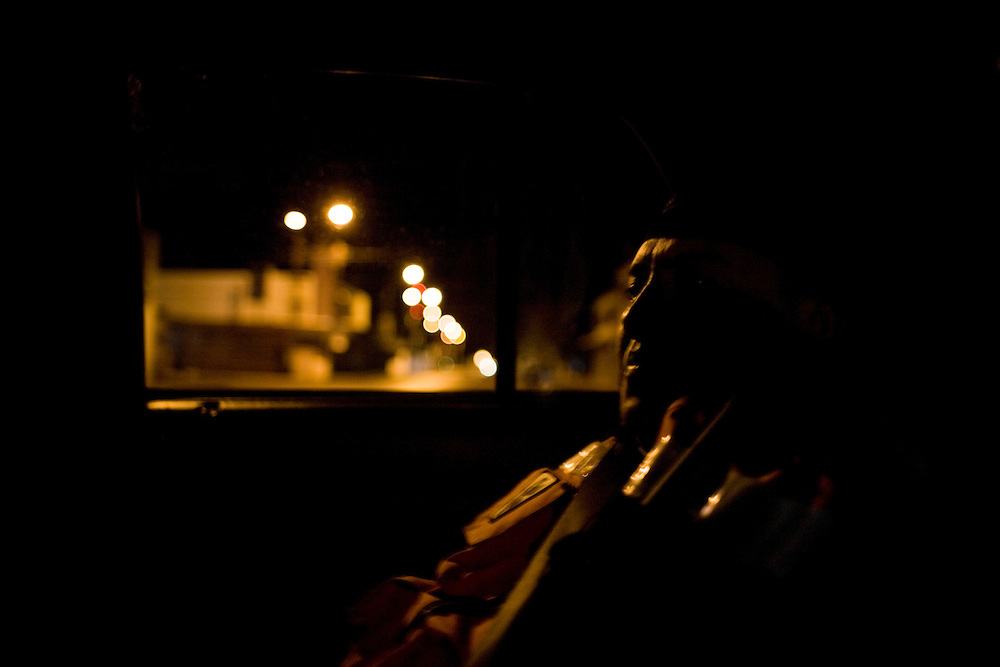 A paramedic catches some sleep in the back seat in the early hours of the morning in Ciudad Juarez, Chihuahua Mexico on May 5, 2010. ..