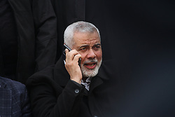 March 30, 2019 - Gaza, Palestine, 30th March 2019. Palestinian demonstrators clash with Israeli soldiers in Abu Safiya, east of the town of Jabaliya in the northern Gaza Strip, during this week Great March of Return protest, with Hamas' political bureau leader Ismail Haniyeh making an appearance at the Abu Safiya site. Thousands of Palestinians had gathered at different sites alongside the eastern borders of the Gaza Strip to take part in the weekly march to break the ongoing Israeli siege and to mark Land Day and the first anniversary of the Great March of Return rallies, and according to the Palestinian Ministry of Health in Gaza, a 17-years-old protester was killed and dozens injured by Israeli troops who had fired live and rubber bullets as well as tear gas at them. Since March 30th 2018, Palestinians have been demanding an end to the 12 year blockade imposed on Gaza by Israel and supported by Egypt, and more than 250 Palestinian demonstrators have been killed and over 23,000 have been injured by the Israeli army since then. This Saturday mass rally was organised on the first anniversary of the launch of the Great March of Return protests and to commemorate Land Day. Land Day falls every year on 30th March to remember the killing of six unarmed Palestinians and the wounding of one hundred during a general strike called  in protest at the expropriation of  21,000 dunams  of Palestinian land by Israel (Credit Image: © Ahmad Hasaballah/IMAGESLIVE via ZUMA Wire)