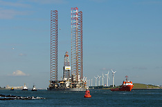 Rotterdam Harbour, Oilplatform towed out of the harbour of Rotterdam, Netherlands