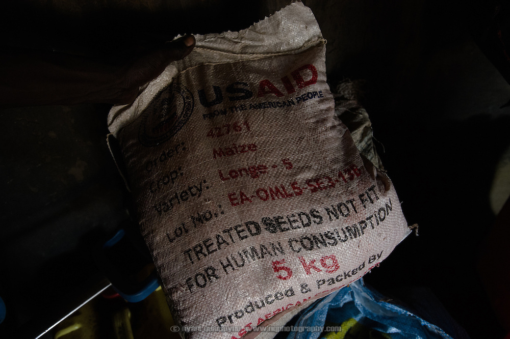 A sack of maize seeds received during a Plan International distribution is seen at the home of Simon Jackson in the village of Kudo in Eastern Equatoria in South Sudan on 8 August 2014. Due to a combination of drought in some parts of the country, the ravages of pests in others, and instability caused by war, many South Sudanese are facing acute food shortages and possibly famine.