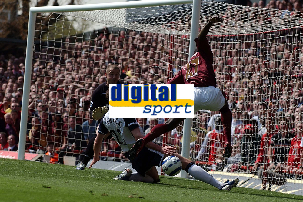 Photo: Olly Greenwood.<br />Arsenal v Tottenham Hotspur. The Barclays Premiership. 22/04/2006. Arsenal's Emmanuel Eboue has a shot at goal , but it is blocked by Spurs' Micahel Carrick.