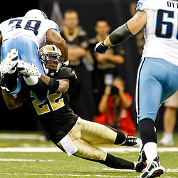September 1, 2011; New Orleans, LA, USA; New Orleans Saints defensive back Tracy Porter (22) tackles Tennessee Titans running back Kestahn Moore (38) during the first quarter of a preseason game at the Louisiana Superdome. Mandatory Credit: Derick E. Hingle