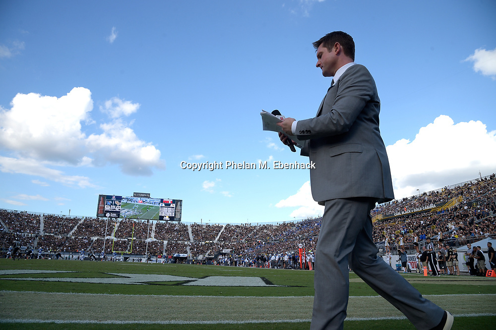 ESPN television football analyst Todd McShay works from the field during the second half of the American Athletic Conference championship NCAA college football game between Central Florida and Memphis Saturday, Dec. 2, 2017, in Orlando, Fla. Central Florida won 62-55. (Photo by Phelan M. Ebenhack)