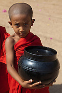 Nearly all Burmese boys become novice monks usually between the ages of 10 and 20.  All things possessed by novice monks must be offered by the community.  The only things allowed to keep are robes, a cup, an umbrella and an alms bowl.