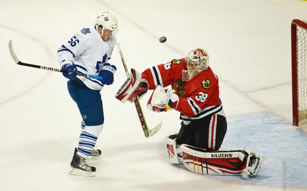 London, Ontario ---10-09-11--- Leaf's rookie Dale Mitchell watches a shot go wide of Chicago Blackhawks goaltender Alex Richards during the Leaf's first gale of the 2010 Rookie Tournament at the John Labatt Centre in London, Ontario, September 11, 2010.<br /> GEOFF ROBINS Toronto Star