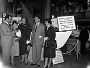 23/04/1960<br /> 04/23/1960<br /> 23 April 1960<br /> Italian Opera Stars at the Dublin Boat Show. Italian Opera Stars who were due to appear in the Dublin Festival of Italian Opera visited the Boat Show at Busaras, Dublin. Picture shows Paolo Silveri (left) Impressario, purchasing a raffle ticket for the motor-boat presented by Irish Shell to the Irish Dingy Association, from Pauline Walker. In the picture are (l-r): Paolo Silveri; Pauline Walker, Irish Dingy Association; Lucilla Udovich, Soprano; A.G. Simon, Sales Manager Irish Shell Ltd. and  Aureliana Beltrami, Soprano