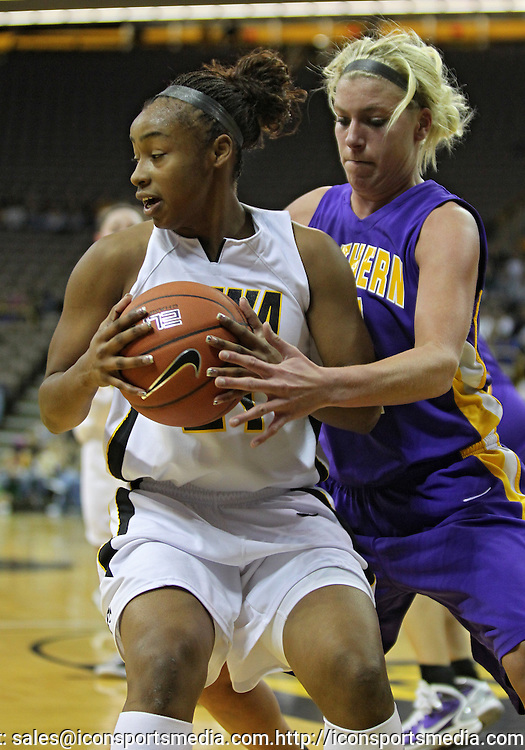 December 22 2010: Iowa guard Kachine Alexander (21) tries to keep the ball away from Northern Iowa guard/forward Erin Brocka (44) during the first half of an NCAA college basketball game at Carver-Hawkeye Arena in Iowa City, Iowa on December 22, 2010. Iowa defeated Northern Iowa 75-64.