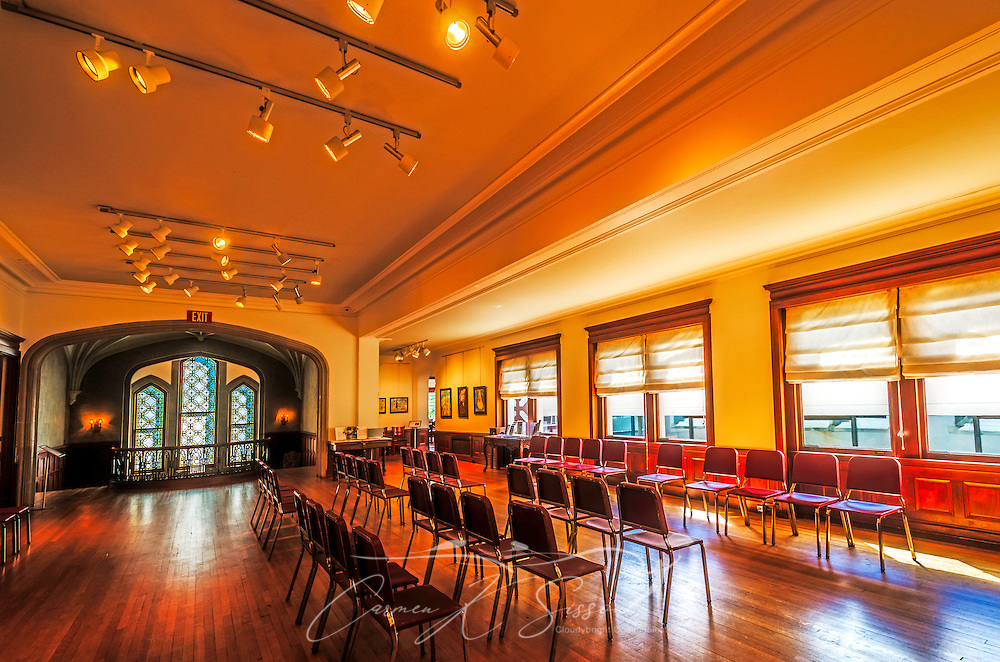 Chairs are lined up in an empty classroom at Callanwolde Fine Arts Center, July 9, 2014. Callanwolde is housed within a 27,000 square foot Gothic-Tudor Revival mansion and nestled on 12 acres in Atlanta, Georgia. The house, built in 1920, was the home of Charles Howard Candler, son of the founder of the Coca-Cola Company. The house was designed by architect Henry Hornbostel. Today, Callanwolde operates as a non-profit organization devoted to teaching and promoting the visual, literary and performing arts. (Photo by Carmen K. Sisson/Cloudybright)