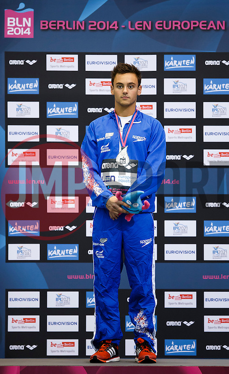 Tom Daley of Great Britain stands on the podium after winning the Silver in the Mens 10m Platform Final - Photo mandatory by-line: Rogan Thomson/JMP - 07966 386802 - 23/08/2014 - SPORT - DIVING - Berlin, Germany - SSE im Europa-Sportpark - 32nd LEN European Swimming Championships 2014 - Day 11.