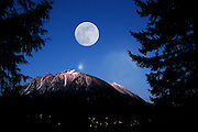 This moonrise over North Bend has been created in Photoshop, but even though it is a composite, it is the actual moon that rose that night. Shot with a Nikon D100, it was made right at dusk on a snowy February.