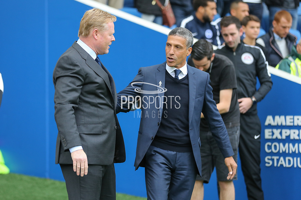 Everton manager Ronald Koeman and Brighton and Hove Albion manager Chris Hughton during the Premier League match between Brighton and Hove Albion and Everton at the American Express Community Stadium, Brighton and Hove, England on 15 October 2017. Photo by Phil Duncan.