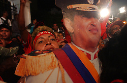 Supporters of President Hugo Chavez gather outside of the presidential palace to show their support after the National Electoral Council announced projections that that the opposition had collected enough signatures to hold a referendum.  The National Electoral Council's announcement capped 6 months of political uncertainty surrounding the referendum.