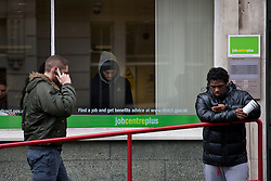 © licensed to London News Pictures. London, UK 15/02/2012. Unemployed young men outside a Jobcentre Plus in Marylebone, London, as the number of young people without a job rose 22,000 to 1.04m, official figures have shown. Photo credit: Tolga Akmen/LNP