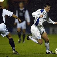 Raith Rovers v St Johnstone...29.11.03<br />Chris Hay gets the better of Shaun Dennis<br /><br />Picture by Graeme Hart.<br />Copyright Perthshire Picture Agency<br />Tel: 01738 623350  Mobile: 07990 594431