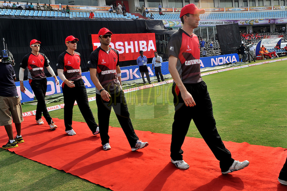 Team Leicestershire Foxes walk to take the field during the CLT20 - Q3 match between Trinidad and Tobago and Leicestershire Foxes held at the Rajiv Gandhi International Stadium, Hyderabad on the 20th September 2011..Photo by Pal Pillai/BCCI/SPORTZPICS