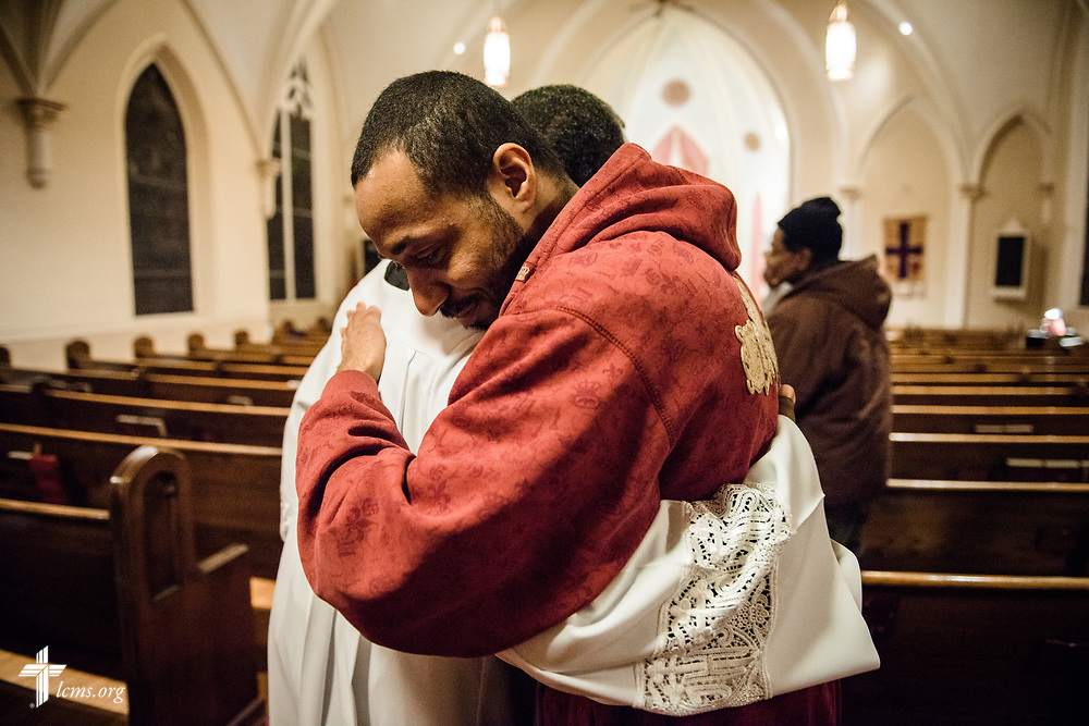 A parishioner hugs the Rev. Delwyn Campbell, national missionary to Gary, Ind., following a Lenten service at St. John's Lutheran Church on Wednesday, April 5, 2017, in Gary. LCMS Communications/Erik M. Lunsford