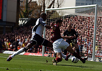 Photo: Olly Greenwood.<br />Arsenal v Tottenham Hotspur. The Barclays Premiership. 22/04/2006. Arsenal's Robin Van Persie is tackled by Spurs' Anthony Gardner.