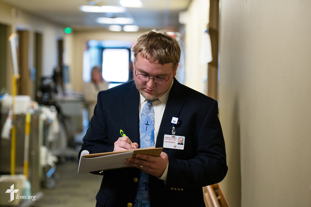 Seminarian Jared Koenig (left) of Concordia Seminary, St. Louis, writes down notes after visiting with a patient on Wednesday, Jan. 14, 2015. LCMS Communications/Erik M. Lunsford