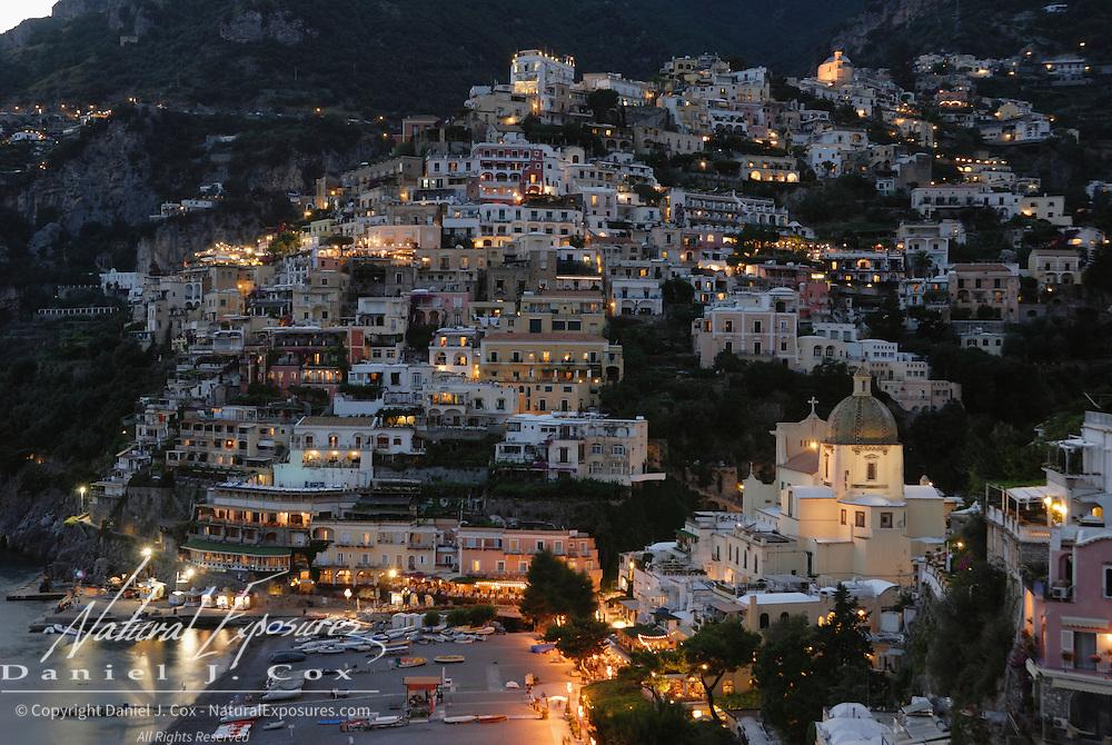 Night falls on Positano, Italy.