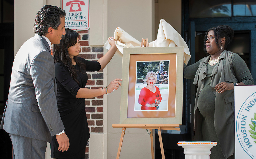 Christian Navarro, Mercedes Diaz Ramirez and Kelly Vaughn-Picton unveil a portrait during a ceremony to rename Jackson Middle School to Navarro Middle School in honor of Yolanda Black Navarro, October 5, 2016.