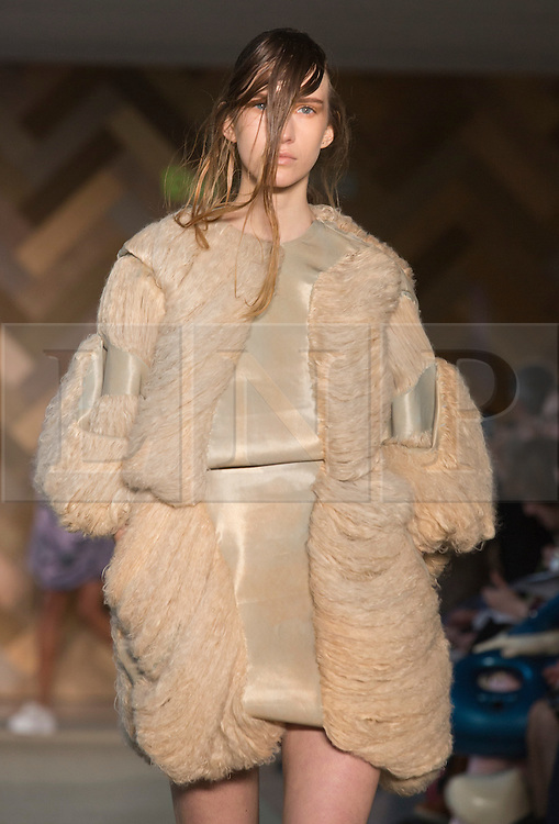 © Licensed to London News Pictures. 29/05/2014. London, England. Collection by Eva-Maria Suviste. 30 students of the Royal College of Art's prestigious MA Fashion programme presented their final collections in  a runway show at the RCA building in Kensington. Photo credit: Bettina Strenske/LNP