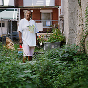 Block Captain Andrea Carter in the raised garden that she created in an abandoned lot on 100 N Peach St. Photo by Lori Waselchuk