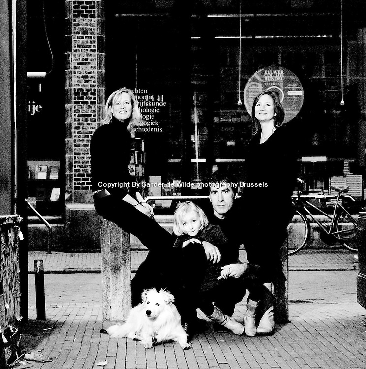Black and White portrait of siblings in front of a bookstore in Groningen, Netherlands.<br />